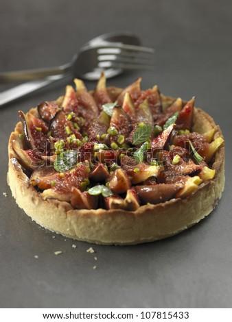 Fig,pistachio and fresh mint tart - stock photo