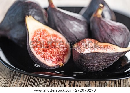Fig. Plate of sliced figs - stock photo
