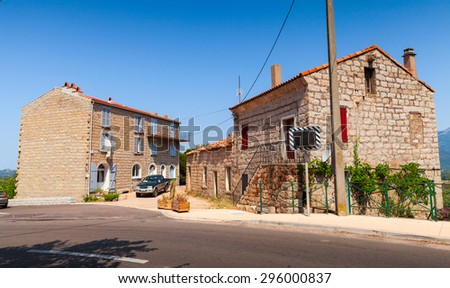 Figari, South Corsica. Old rurar houses made of stones with red tile roofs, wooden doors and windows - stock photo