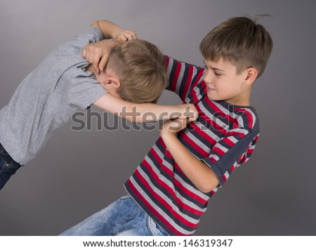 fight between brothers - stock photo