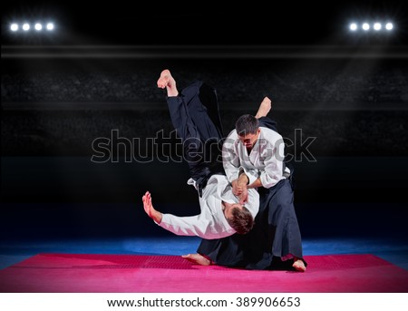 Fight between two aikido fighters at sport hall - stock photo