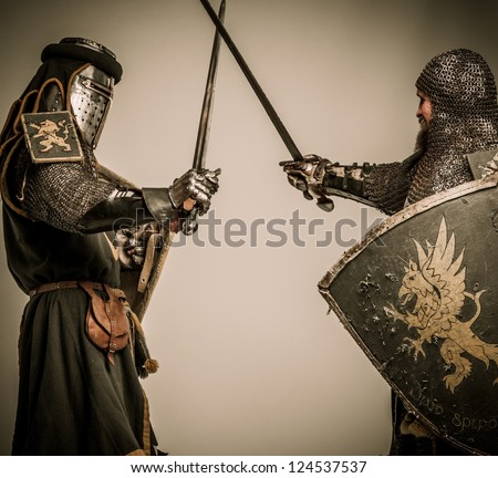 Fight between two medieval knight - stock photo