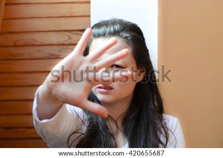 Fight for women's rights. Gender equality concept. Abused woman shows stop.  - stock photo