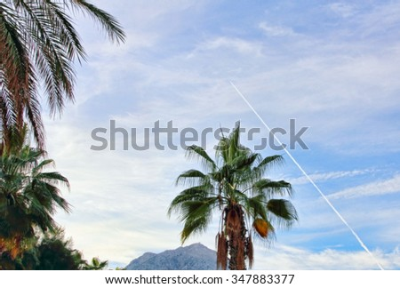 Fighter aircraft fuel trace in the blue sky over turkish Tahtali mount. - stock photo