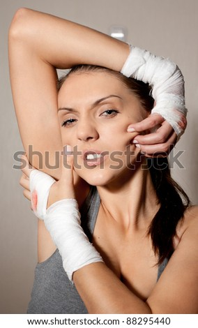 fighter girl with bandage on hands after fight - stock photo