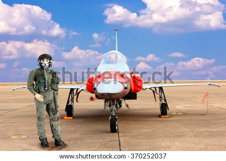 Fighter pilot and Military airplane F16 - stock photo