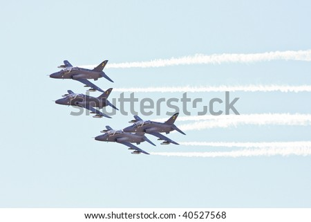 fighter planes flying in formation - stock photo