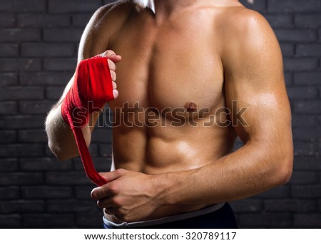 Fighter Preparing Bandages For Training - stock photo