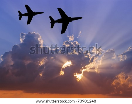 Fighters patrol at sunset - stock photo