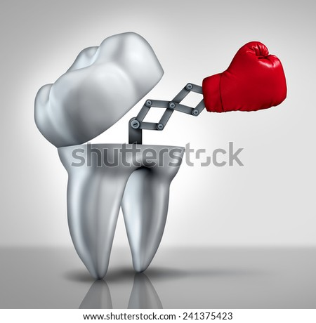 Fighting cavities and dental health care concept as an open molar tooth with a red boxing glove emerging to fight tooth decay as a hygiene symbol of dentistry and dentist services. - stock photo