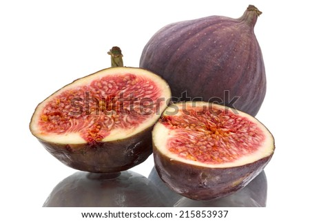 Figs and two halves isolated on white background - stock photo