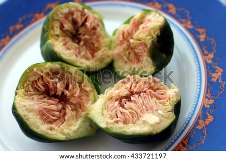 Figs on plate, top view, food background - stock photo