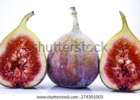 Figs whole and halved shot close-up on white background - stock photo