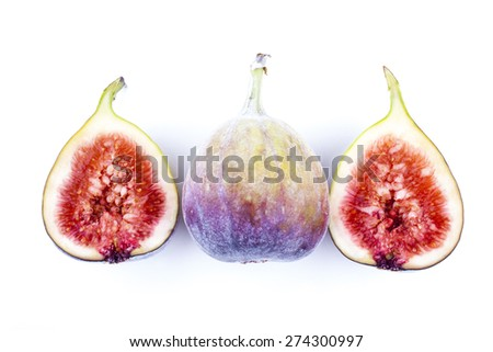 Figs whole and halved shot on white background - stock photo