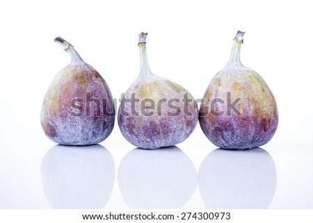 Figs whole shot on wood front view white background - stock photo