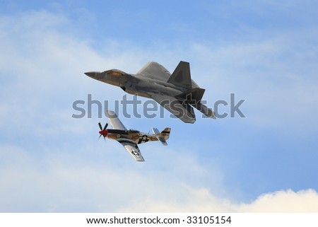 Figters F22 Raptor and P-51 Mustang - stock photo