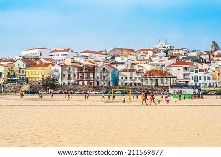 FIGUEIRA DA FOZ, PORTUGAL - Typical portuguese buildings, beach and coast of Figueira da Foz, ocean resort on the coast of Atlantic ocean: Figueira da Foz, Portugal, September 09, 2012. - stock photo
