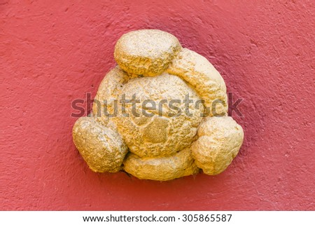 FIGUERAS, SPAIN - MAY 25, 2015: Closeup of bread on the wall of Dali's Museum building in Figueras, Catalonia. Dali's favourite bread on Galathea's tower - stock photo