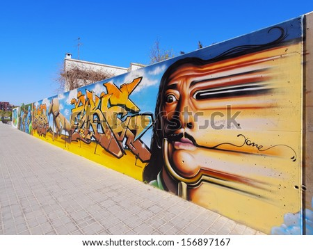 FIGUERES, SPAIN - APRIL 14: Graffiti showing Salvador Dali face on April 14, 2013 in Figueres, Catalonia, Spain. Salvador Dali is a famous surrealist artist and Figueres is his home town. - stock photo
