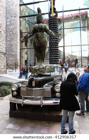 FIGUERES, SPAIN -December 9, 2015: Tourists looking at the exhibits and details from the interior of the famous museum and theatre of Salvador Dali in his home town of Figueres, in Catalonia, Spain.  - stock photo