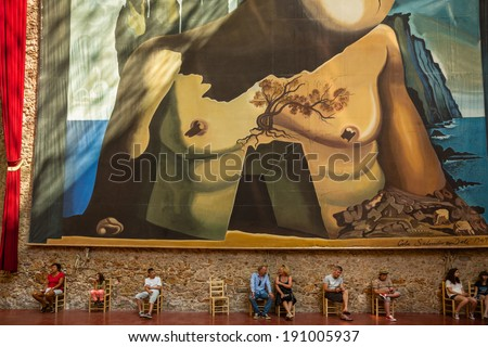 FIGUERES, SPAIN - JUL 15: Tourists sit under giant Dali painting at Dali Museum on July 15, 2013 in Figueres, Spain - stock photo