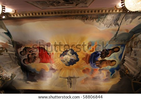 FIGUERES, SPAIN - JULY 27: Dali's bedroom in Dali Museum in Figueres, Spain at July 27, 2010. Ceiling painting in the room Palace of the Winds, featuring giant, barefoot figures of Dali and Gala. - stock photo