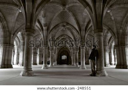 figure at the cloisters - stock photo