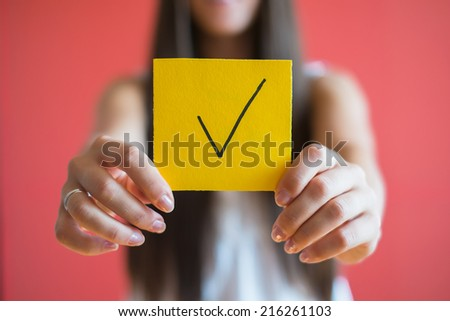 Figure checkmark icon in the hand - stock photo