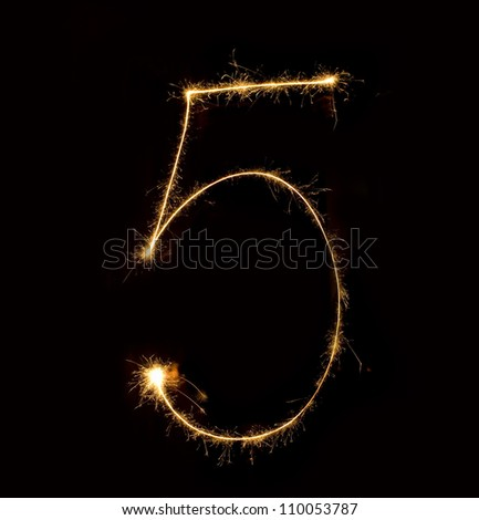 Figure five.abstract sparkler figures on black background. - stock photo