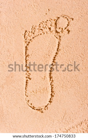 Figure left foot man on the beach in the sand - stock photo