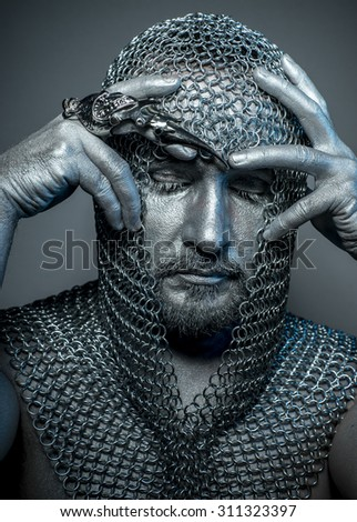 Figure, medieval executioner mesh iron rings on the head - stock photo
