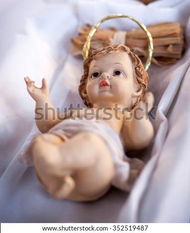 figure of baby jesus in manger - nativity scene - stock photo