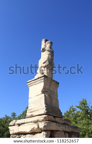 Figure of Triton in the Odeion of Agrippa, Athens, Greece - stock photo
