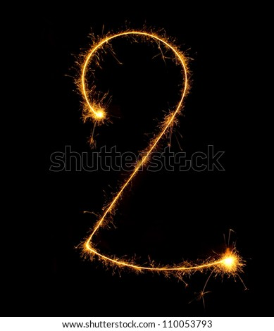 Figure two.abstract sparkler figures on black background. - stock photo