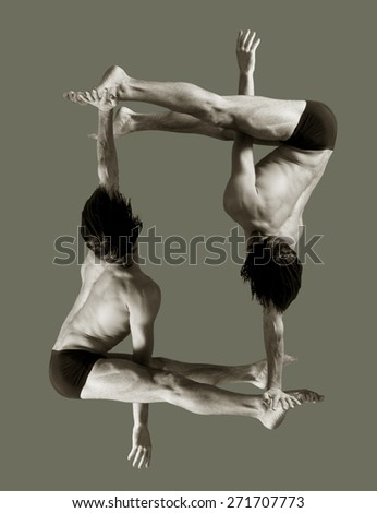 Figures gymnasts on a gray background.Athletes.Handstand.Sepia - stock photo