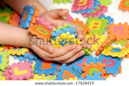 Figures, letters in children's hands - stock photo