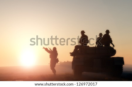 Figures of men and military equipment in the sun. - stock photo