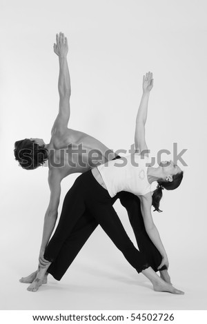 Figures of the man and the woman in sportswear on a white background - stock photo