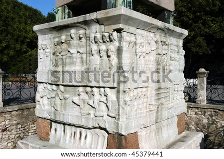 Figures on the base of egypt obelisk in Istanbul, Turkey - stock photo