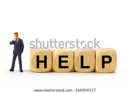 Figurine from Manager with Cubes on bright Background - stock photo