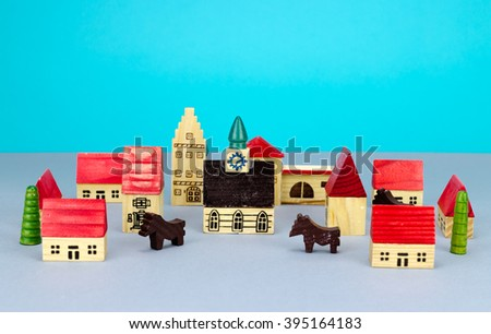 Figurine hometown on blue background - stock photo