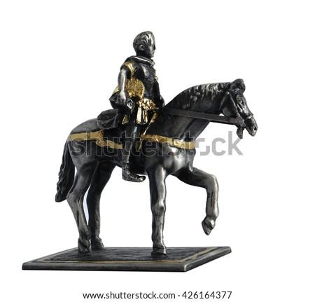 Figurine of Gaius Julius Caesar on a horse isolated on white background                                - stock photo