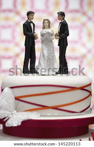 Figurines on Wedding Cake - stock photo