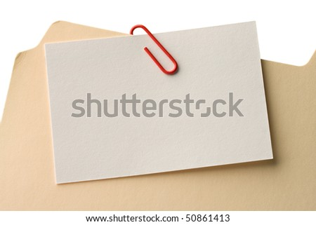 File folder clipped with a blank attachment. - stock photo