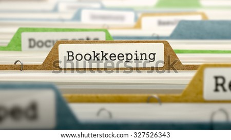 File Folder Labeled as Bookkeeping in Multicolor Archive. Closeup View. Blurred Image. - stock photo