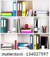 File folders, standing on the shelves at office - stock photo