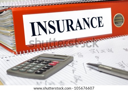 file marked with insurance - stock photo