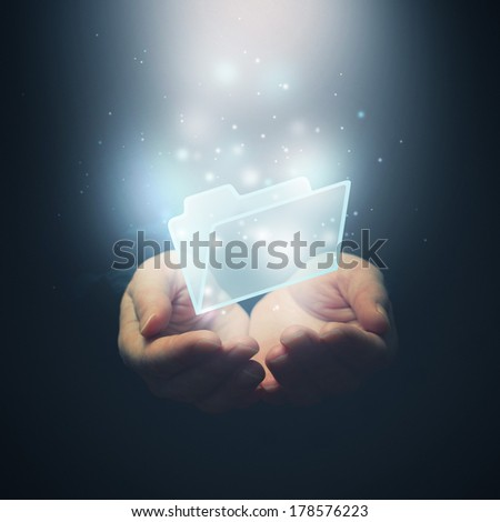 File protection, file download and data security concept. Open hands with file document file folder. - stock photo