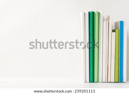 Files.Paperwork on Desk.Blank stucco wall your message. - stock photo