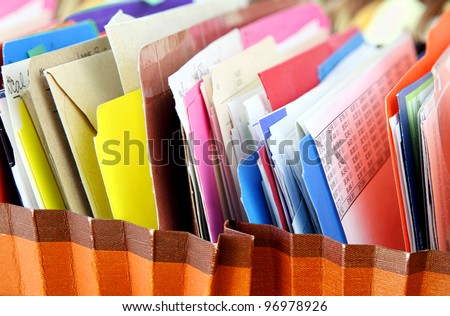 Files. Row of folders in expending file pockets - stock photo